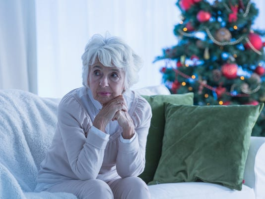 Senior woman sitting alone