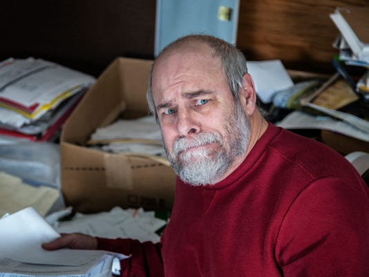 Senior Adult Man Hoarder In Messy Office Room