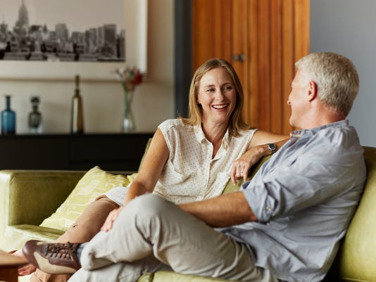 Couple spending leisure time in living room