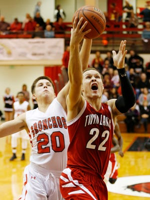 Bryce Bennington of Twin Lakes gets around Danny Isbell of Lafayette Jeff for a score the semifinals of the J&C Hoops Classic Friday, December 2, 2016, at Lafayette Jeff. Twin Lakes knocked off the defending champion Bronchos 55-39 to advance to J&C Hoops Classic championship to face McCutcheon Saturday.