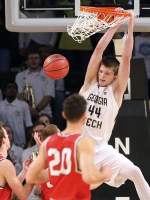 Georgia Tech's Ben Lammers dunks over three Belmont defenders in the first half Sunday.