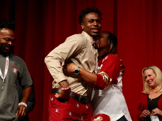 North Fort Myers running back Zaquandre White gets a hug from his mother Dorothy after signing with Florida State University Wednesday.