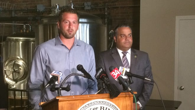 Binghamton Brewfest organizer Jordan Patch and Mayor Rich David, right,  encourage the community to attend Saturday's event. More than 70 breweries will serve their craft beer.