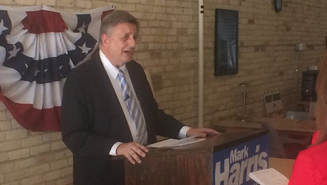 Democrat Mark Harris appears at a news conference Wednesday in Oshkosh. He is challenging both of his potential Republican opponents to a series of debates in all 11 counties of the 6th Congressional District.