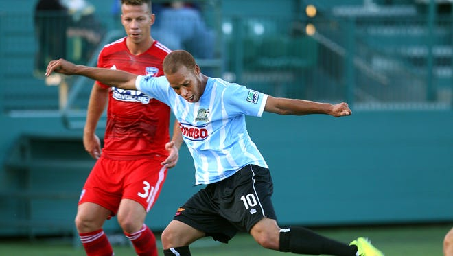 The Rhinos' J.C. Banks scores a first-half goal against FC Dallas on Friday.