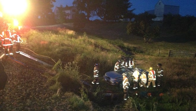 Firefighters and paramedics responded to a vehicle over an embankment on Friday, July 4.