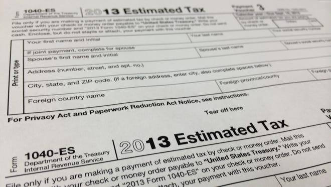 A 2013 1040-ES IRS Estimated Tax form at H & R Block tax preparation office.