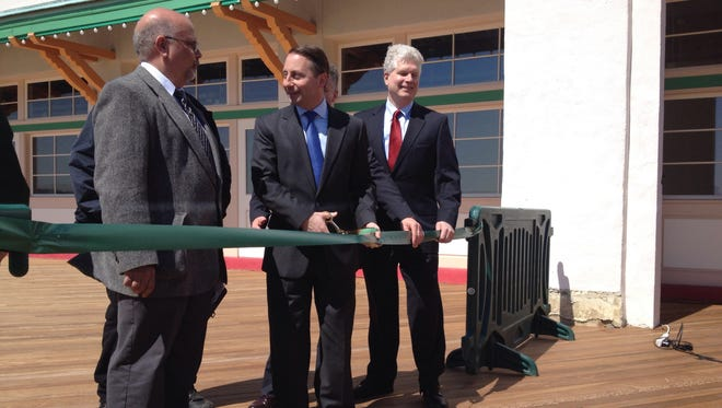 Westchester County Executive Rob Astorino, center, formally reopened the boardwalk in Playland Park in Rye Thursday, April 10, 2014 after extensive work to repair damage from Hurricane Sandy.