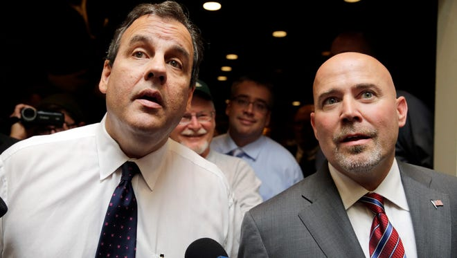 New Jersey Gov. Chris Christie, left, and Republican candidate for New Jersey's 3rd Congressional District, Tom MacArthur, right, listen to a question Thursday, Oct. 23, 2014, in Bordentown, N.J. Gov. Chris Christie is lending his star power to the Republican running for a southern New Jersey House seat. MacArthur is running against Democrat Aimee Belgard in the district, which is split between Burlington and Ocean counties. The seat is open because Republican Rep. Jon Runyan is not seeking re-election. (AP Photo/Mel Evans)