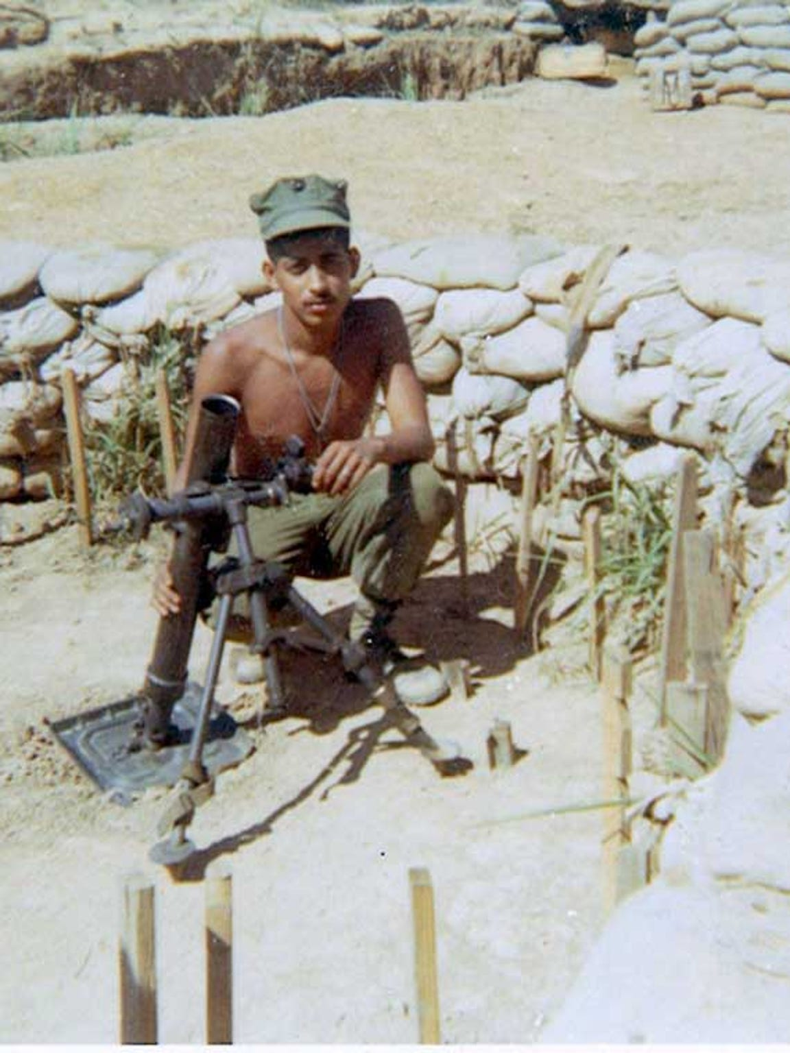 Ronald Reyes, a Marine, was killed in 1968 in Khe Sanh, Vietnam. His son Ronald R. Reyes, 49, of Moorpark, Calif., is participating in a meeting of adult children, who lost parents from opposing sides in the Vietnam War.