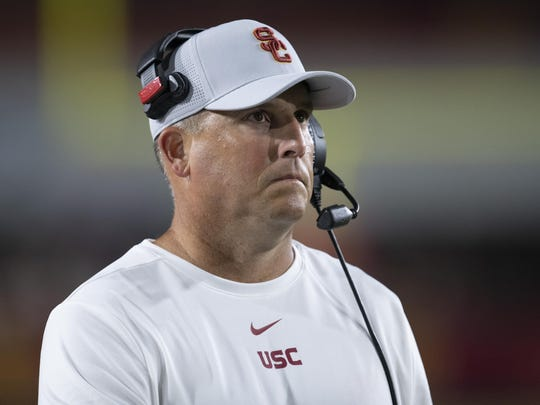 Southern California head coach Clay Helton watches an NCAA college football game against Fresno State in Los Angeles.