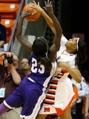UTEP guard Sparkle Taylor blocks a shot put up by ACU Wildcats forward Suzzy Dimba during first half play in the first round WNIT game played at the Don Haskins Center. The Miners won 66-62 and will now play Arkansas State in a second round game Monday night in the Don Haskins Center.