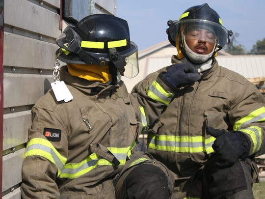 Clarksville Fire Rescue recruits Dominique White (left)