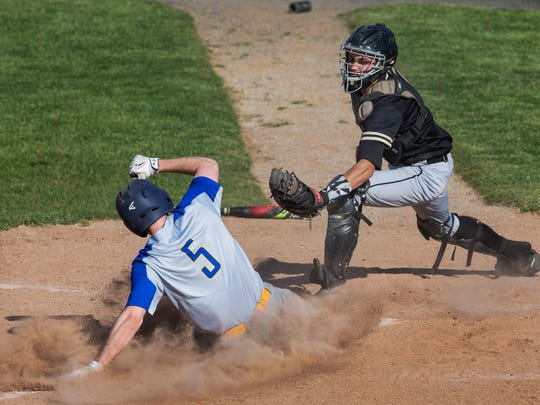 Manchester's Kirk Montanye slides safely into home ahead throw during fifth inning action. Manchester vs Southern Regional in Ocean County Tournament Semifinal game on May 16, 2017 in Stafford NJ