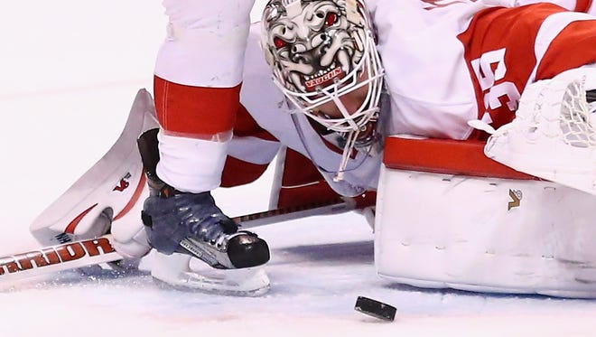 Jimmy Howard makes a save before getting pulled Thursday night against the Bruins.