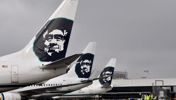 Tail sections of Alaska Airlines  Boeing 737s are seen