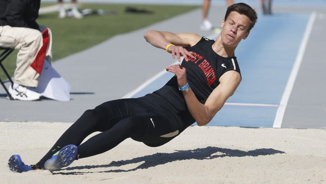 West Branch's Cooper Koenig competes Thursday, May 21, 2015 in the boys long jump at the 2015 State Track Meet in Des Moines.