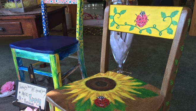Dressed-up children's chairs are showing up in windows in downtown Shippensburg to promote the Shippensburg Public Library's April 2 fundraising gala. This pair is on display at East Meets West, 29 E King St.