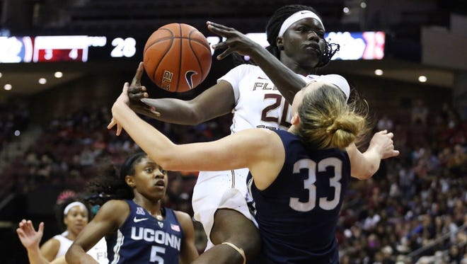 Shakayla Thomas drives to the basket vs. UConn.
