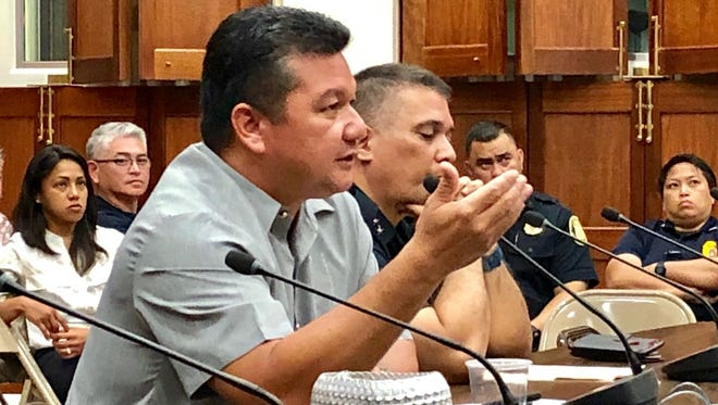 Acting director of Guam Customs and Quarantine Agency, Eric Palacios, gestures while responding to senators' questions during Monday night's hearing on his confirmation.