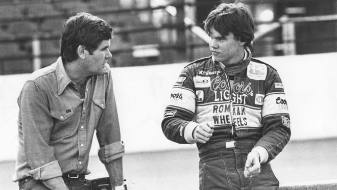 Al Unser and Al Unser Jr discuss racing strategies.  Date and photographer unknown