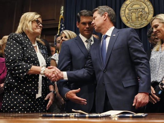 "After the signing, Gov. Brian Kemp congratulates Sen. Renee Unterman, R-Buford, on May 7, 2019 in Atlanta, Ga. Kemp signed HB 481, the ""heartbeat bill,"" on Tuesday, setting the stage for a legal battle as the state attempts to outlaw most abortions after about six weeks of pregnancy. (Bob Andres/Atlanta Journal-Constitution/TNS)"