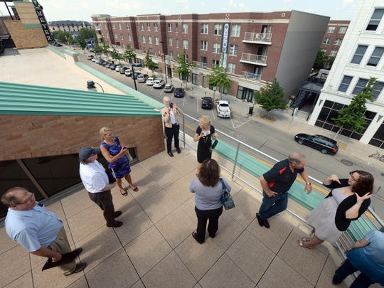 Visitors tour the rooftop area of the Breakthrough Fuels offices overlooking Washington Street in the Backstage at the Meyer building.