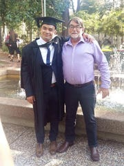 Karlin Katrein and his father celebrate his university graduation in 2017.