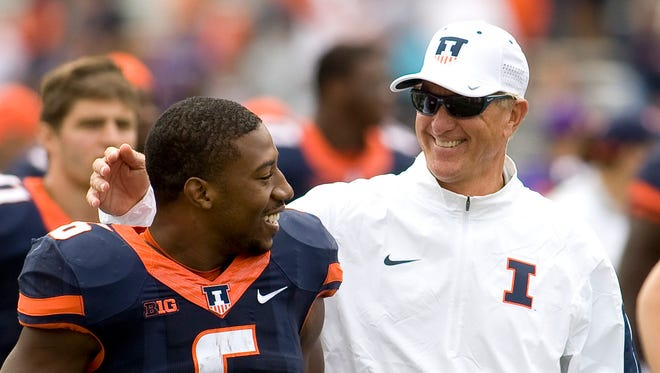 Fighting Illini head coach Bill Cubit with with running back Josh Ferguson (6) after a win Sept. 12.