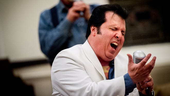 Elvis impersonator Joe Forrester belts out a verse from 'Bridge Over Troubled Water' during his performance at St. Paul United Church of Christ in Shrewsbury. This is Forrester's second year doing a gospel performance for Lent at the church.