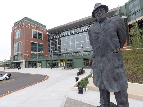 The statue of Vince Lombardi stands on Harlan Plaza awaiting the crowds for Green Bay Packers games at Lambeau Field, 1265 Lombardi Ave.
