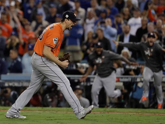 Houston Astros' Charlie Morton reacts after Game 7 of baseball's World Series against the Los Angeles Dodgers Wednesday, Nov. 1, 2017, in Los Angeles. The Astros won 5-1 to win the series 4-3. (AP Photo/Matt Slocum)