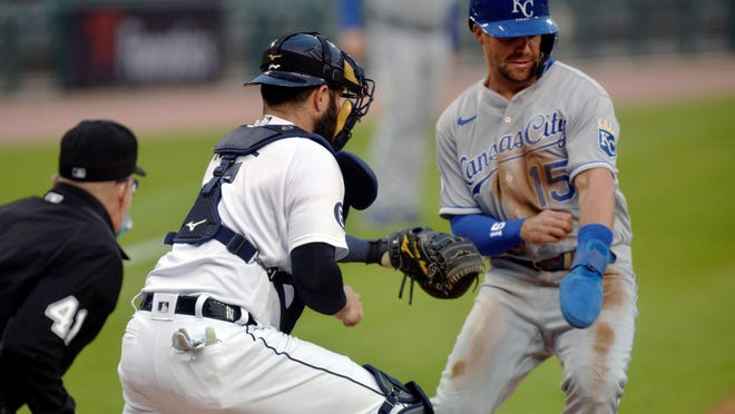 Detroit Tigers catcher Austin Romine tags out the Kansas City Royals' Whit Merrifield at home plate during Tuesday night's game in Detroit.