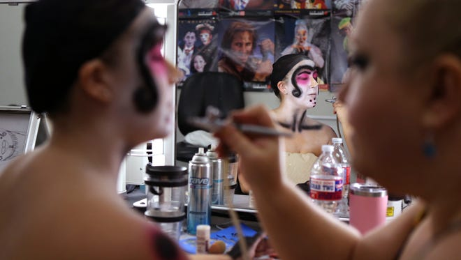 Lucy Stephens (left) has makeup applied by Del Mar College student Dallys G. Eggett as she creates a science fiction character in preparation for the final project in a Del Mar College makeup class on Thursday, November 30, 2017. The Project Del Mar presentation includes a reveal of the characters onstage. Students were required to create a story of their character.