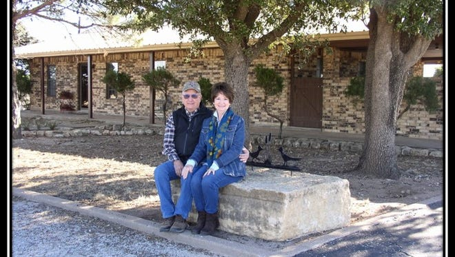 Rodney and Carolyn Flanagan in front of their Runnels County ranch home.