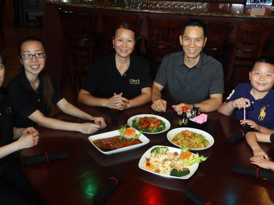 Jeff Chen, center, owner of Chen's China Bistro is pictured at the restaurant with his family. From left to right are Selene, 22, Huimin, 21, his wife Anita, Jeff Chen, Samuel, 9, and Katie, 8. Chen's is a true family restaurant and the meals they are preparing for Chinese New Year are traditional but with an American twist.