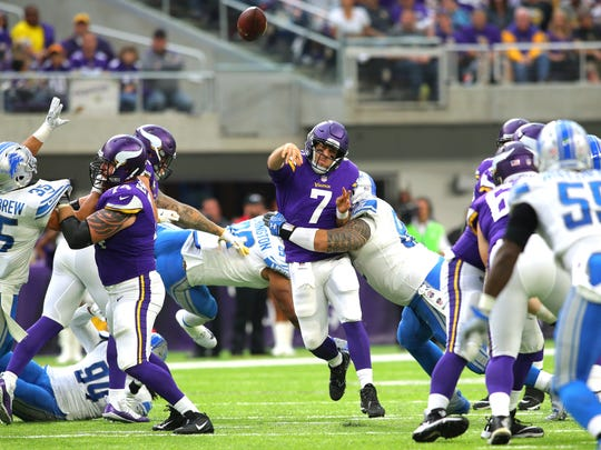 Vikings quarterback Case Keenum is hit by Haloti Ngata while throwing in the second half of the Lions' 14-7 victory on Oct. 1, 2017 at U.S. Bank Stadium in Minneapolis.