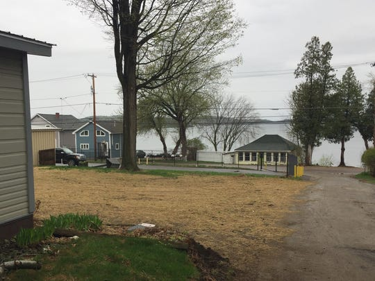 Straw lies on the site of a recently demolished home Monday on Malletts Bay. Six homeowners along East Lakeshore Drive and Lone Birch Street opted to level their homes before the April 30 termination of their leases. Photographed May 1, 2017.