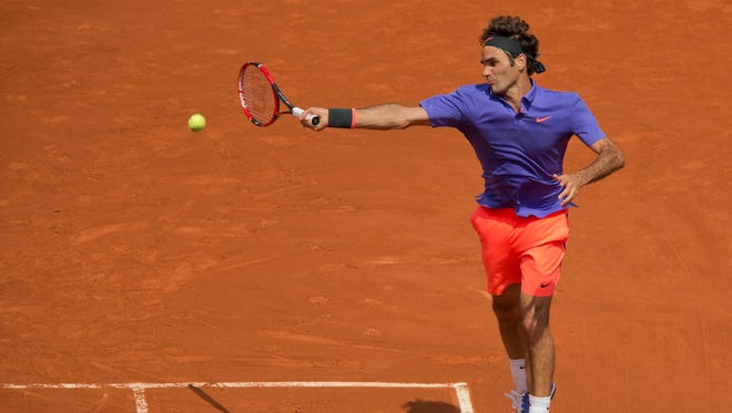 Roger Federer (SUI) in action during his match against Marcel Granollers (ESP) on day four of the French Open at Roland Garros on May 27, 2015.