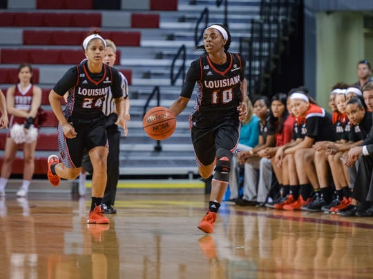 Keke Veal (24) and Kia Wilridge (10) go down the floor Thursday in the Cajuns' loss to Troy.