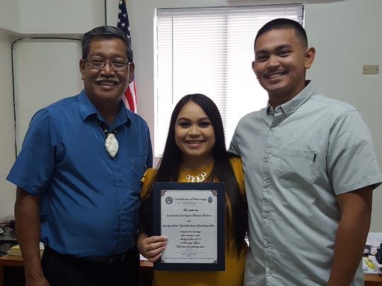 Lorenzo Enrique Flores and Jacqueline Elizabeth Quintanilla were wed on June 8 by Sen. Joe S. San Agustin, left, at his office in Tamuning.