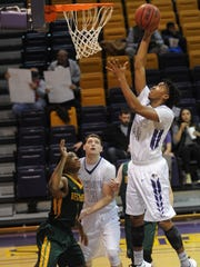 Hardin-Simmons' Nathaniel Jack, right, sails toward the basket while teammate Ryan Leiss (13) and a Belhaven defender look on. The Cowboys beat Belhaven 106-81 on Saturday, Dec. 17, 2016 at the Mabee Complex.