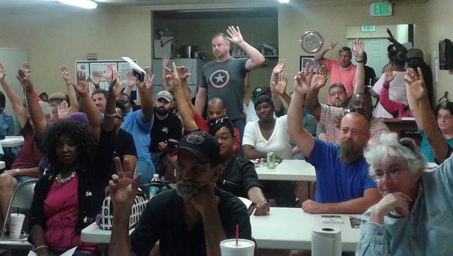 Escambia County drivers and mechanics make a vote of no confidence in First Transit Corporate on Sunday, April 23, 2017. The Ohio-based company manages day-to-day operations of Escambia County Area Transit and Escambia County Community Transit.