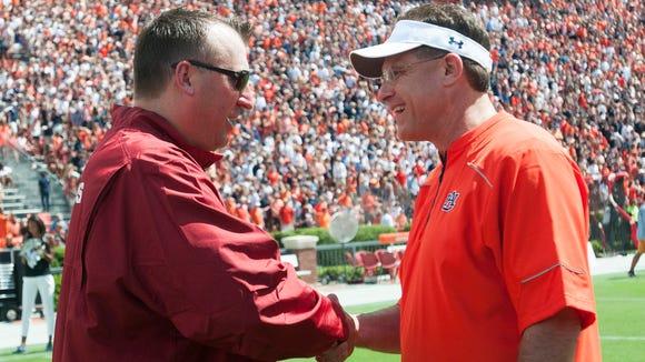 Arkansas coach Bret Bielema shakes the hand of Auburn coach Gus Malzahn before the start of their game in August.
