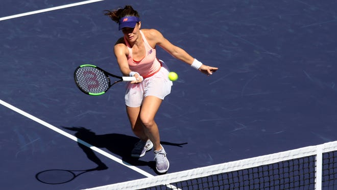 American Nicole Gibbs goes to net during her match with Heather Watson, of Great Britain during the first Wednesday of the BNP Paribas Open on Wednesday, March 8, 2017 in Indian Wells, CA.