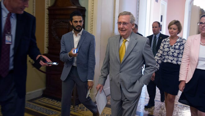 Senate Majority Leader Mitch McConnell, R-Ky., walks to the Senate Chamber to begin a special session to extend surveillance programs,  in Washington, Sunday, May 31, 2015.   The Senate was unable to make a deal to extend contested anti-terror provisions and as a result, the post-Sept. 11 programs expired at midnight Sunday. (AP Photo/Cliff Owen)