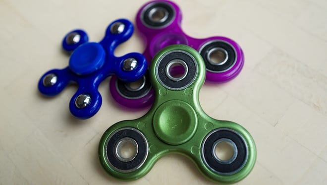 Fidget spinners have become the latest toy sensation and some schools have banned them because they've become a distraction.