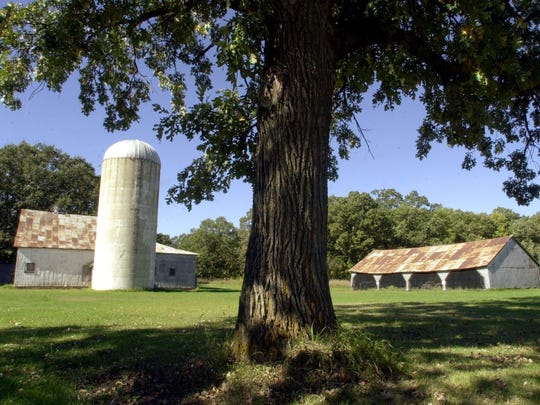 Historic farm buildings remain at Bend in the River Regional Park near Rice.