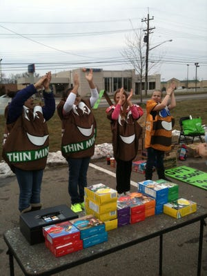 Girl Scouts will sell cookies at a drive-thru on Super Bowl Sunday.