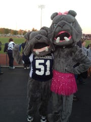 The Bulldog and Bulldogette mascots strike a pose before Friday's game.